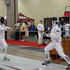 Sam Hayden, left, in the Y12 Men's Epee.