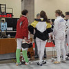 Nina Moiseiwitsch gathers with her pool at the start of the Y14 Women's Epee.