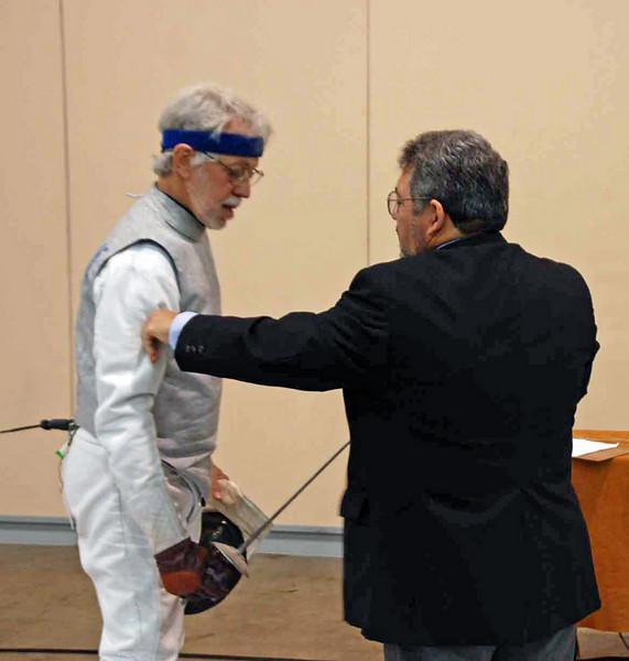 Michael Burack competes in the Veteran-60+ Men's Foil.