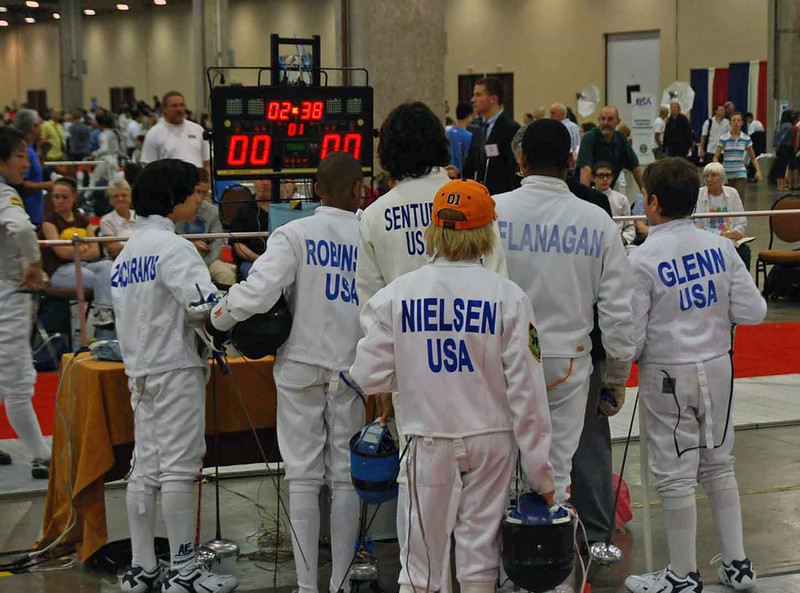 Seth Flanagan gathers with the other members of his pool in the Y12 Men's Epee.