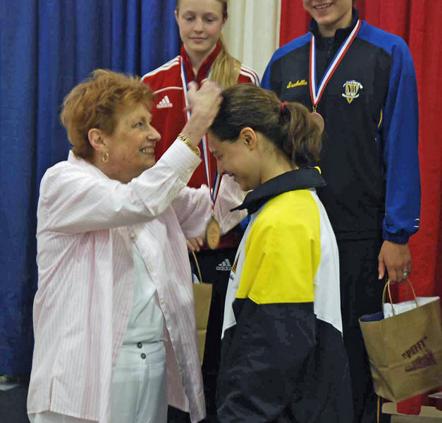 Katharine Holmes receives her gold medal in the U16 Women's Epee.