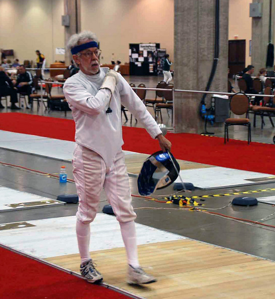 Michael Burack in the Veteran-60+ Men's Epee.