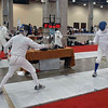Michael Burack (left) competes in the Veteran-60+ Men's Epee.