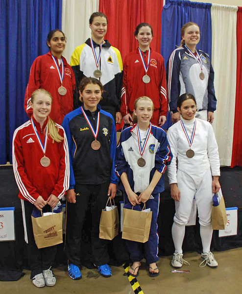 The finalists in the U16 Women's Epee.  Back row, from left: Mandeep Bhinder (3rd), Katharine Holmes (1st), Ashley Severson (2nd), Emma Peterson (3rd).  Bottom row, from left: Catherine Lee (8th), Isabella Barna (6th), Aleina Edwards (5th), and Isabel Ford (8th).