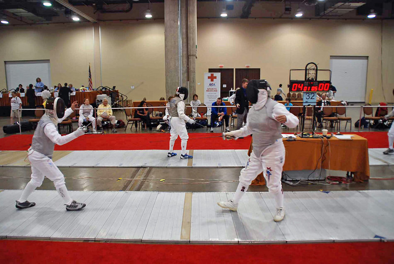 Bettie Graham (left) in the Veteran-60+ Women's Foil is victorious, 5-0, over Pat Bedrosian (who eventually won the event).