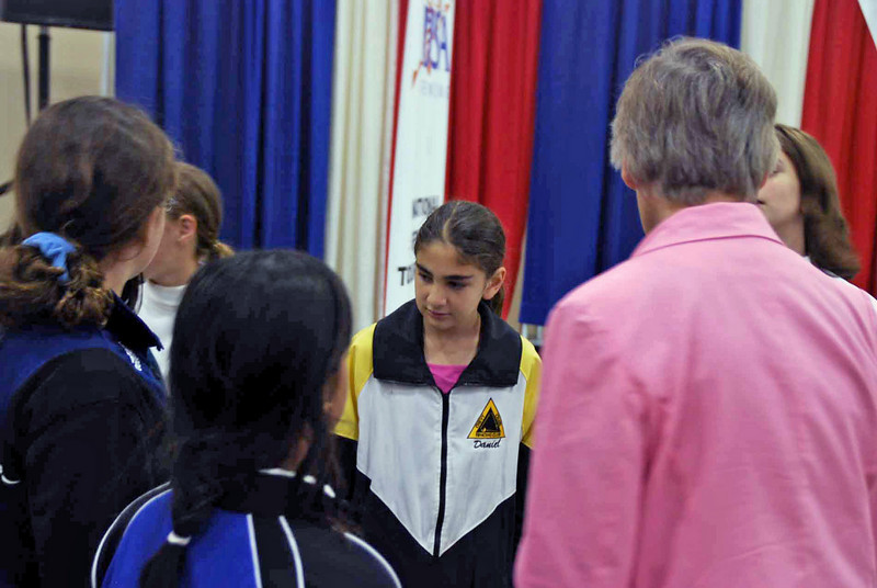 The Y10 Women's Epee finalists gather for the medal ceremony.