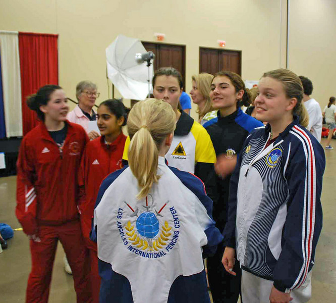 The finalists in the U16 Women's Epee gather for their award ceremony.