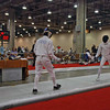 Ben Cohen (left) in the Division IA Men's Epee.