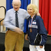 Ruth Anderson receives the 7th place medal in Veteran-60+ Women's Epee.