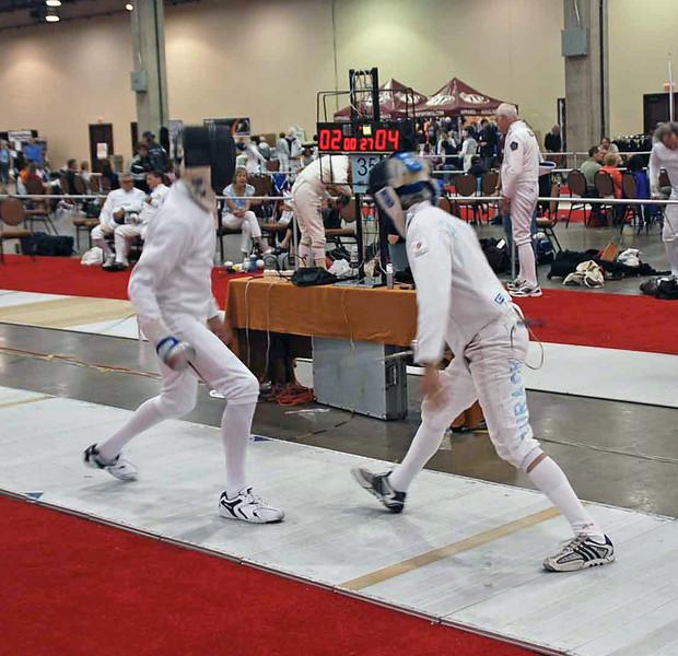 Michael Burack (left) competes in the Veteran-60+ Men's Epee.