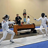 Olivia Morreale (left) competes in the Y12 Women's Epee.  She finished 4-2 in the pools and seeded 14th out of 55 entries.