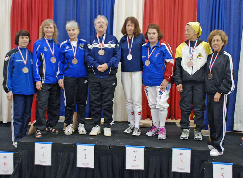 The finalists in Veteran-60+ Women's Foil.  From left: Kerry Schaefer (8th), Patricia Lutton (6th), Ellen O'Leary (3rd), Patricia Bedrosian (1st), Joanne Stevens (2nd), Diane Reckling (3rd), Bettie Graham (5th) and Catherine Radle (7th).