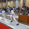 Katharine Holmes, right, in the U16 Women's Epee.  Katharine was undefeated in her pool.