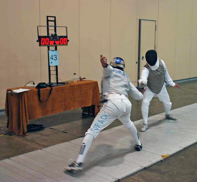 Michael Burack (left) competes in the Veteran-60+ Men's Foil.