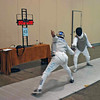 Michael Burack (left) competes in the Veteran-60+ Men's Foil.