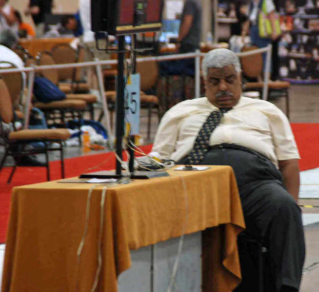 Referee Gamal Mahmoud relaxes between rounds.