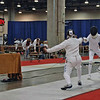 Siobhan Fabio (left) wins her first DE in the Division III Women's Epee with a final score of 15-6.