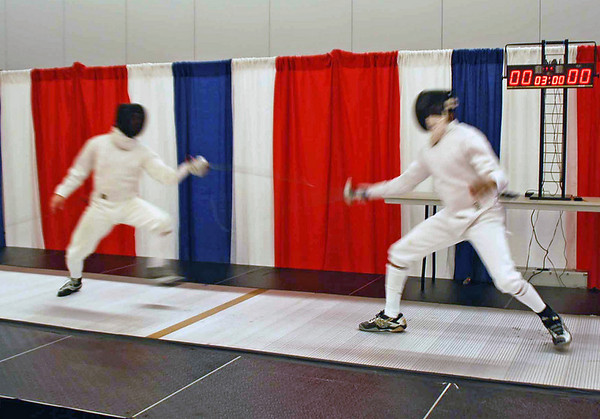 Lewis Sloter (left) warms up on the gold medal strip before the Division I Men's Epee.