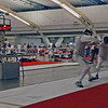 Julian Moiseiwitsch (right) scores the winning touch in the Veteran Combined Men's Foil.