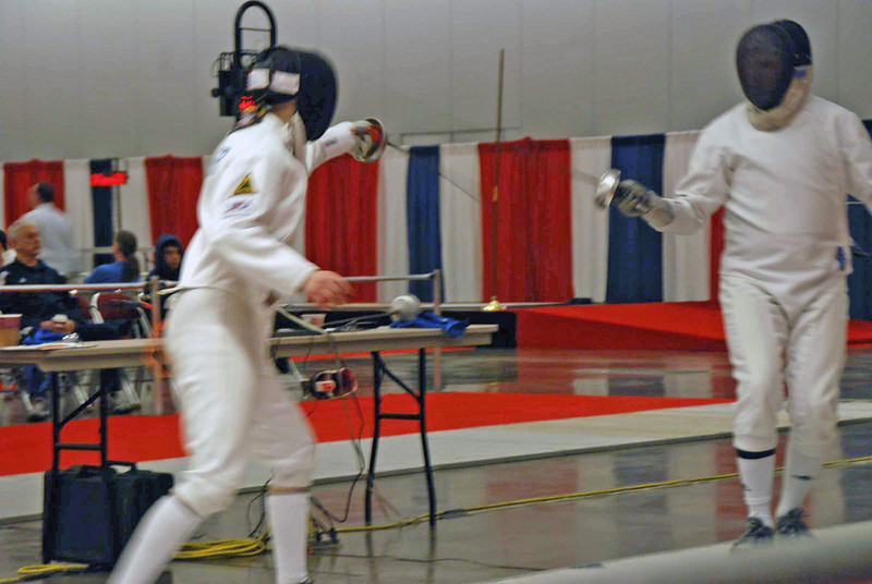 Lewis Sloter (left) in the Division I Men's Epee.