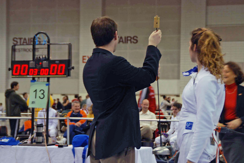 The referee checks Ella Barnes epee before her bout in the Junior Women's Epee.