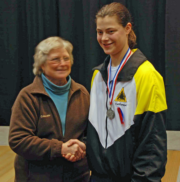 Katharine Holmes receives her 2nd place medal in Junior Women's Epee from Nancy Anderson, former president of the USFA.