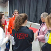 The Division III Women's Epee finalists receive their presentation instructions from Carol Buerdsell.