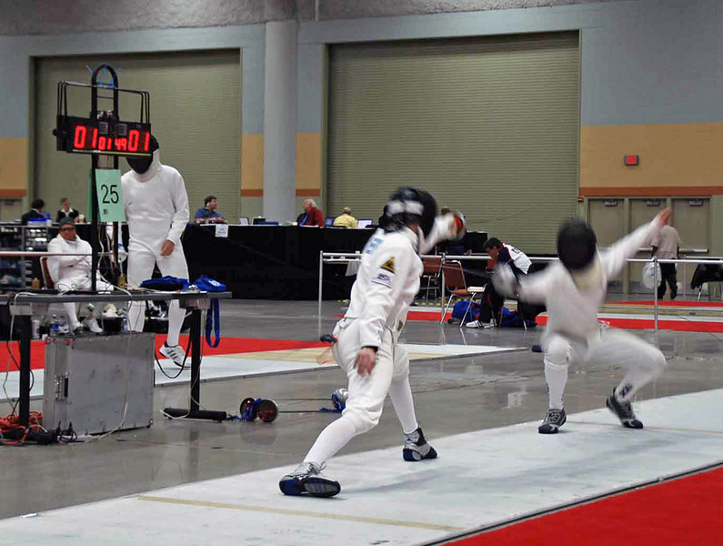 Lewis Sloter (left) in Division II Men's Epee.