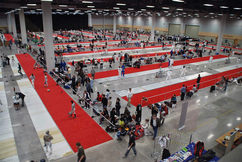The venue at the Des Moines Convention Center, with fencers.