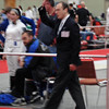 Lewis Sloter referees in the Division III Women's Epee.