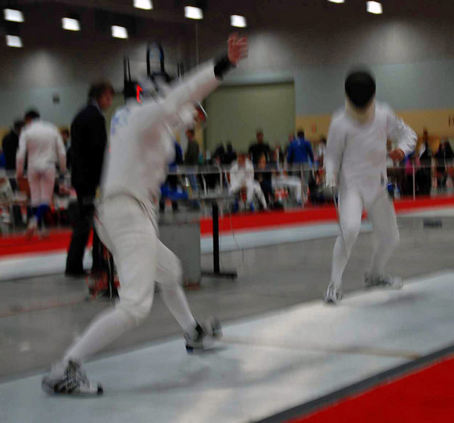 Lewis Sloter (left) in the Division II Men's Epee direct elimination.