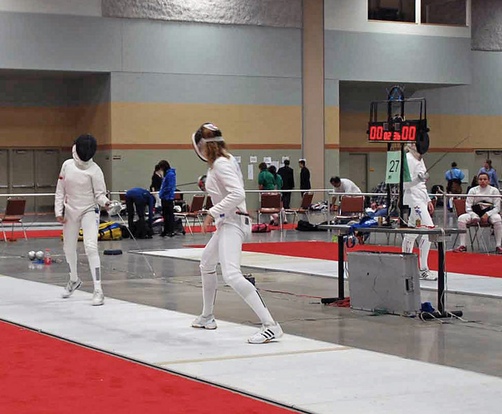 Ella Barnes fences in the direct elimination in Cadet Women's Epee.