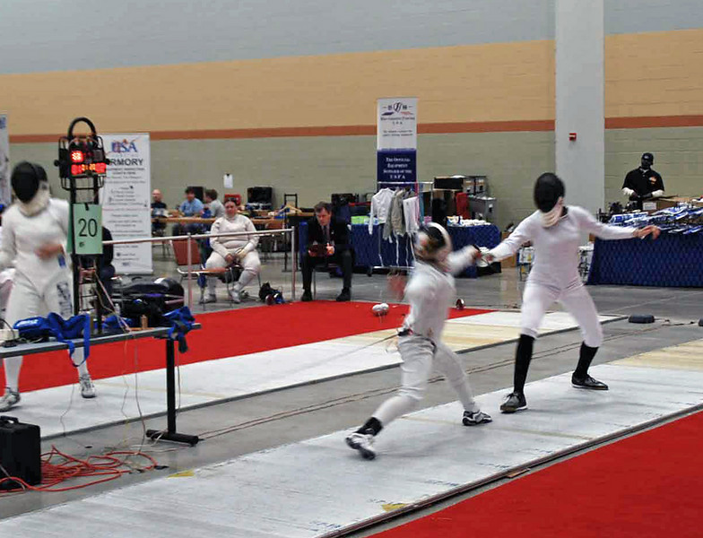 Olivia Morreale scores a touch in the Division III Women's Epee.