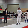 Katharine Holmes fences in the direct elimination in Cadet Women's Epee.