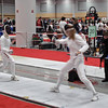 Ella Barnes (right) fences a Canadian in the Division II Women's Epee.