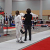 Nina Moiseiwitsch (left) fences in the direct elimination in Cadet Women's Epee.