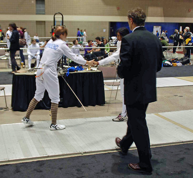 Carolyn Townsend (left) shakes hands with her opponent after winning her first bout.