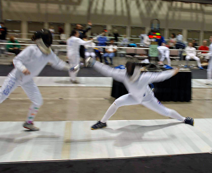 Katharine Holmes (right) scores in Junior Women's Epee.