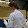 Katharine Holmes checks her epee tip before the round of 8 bout.