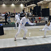 Ella Barnes (right) scores in Junior Women's Epee.