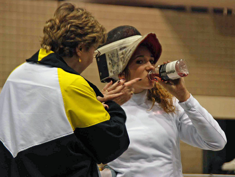 Coach Jean Finkleman helps Ella Barnes during a break in her DE in Cadet Women's Epee.