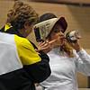 Coach Jean Finkleman helps Ella Barnes during a break in her DE in Cadet Women's Epee.