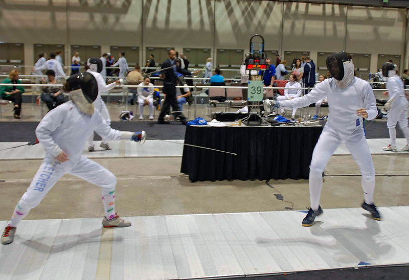 Katharine Holmes (right) seeded 1st after being undefeated in pools in Junior Women's Epee.
