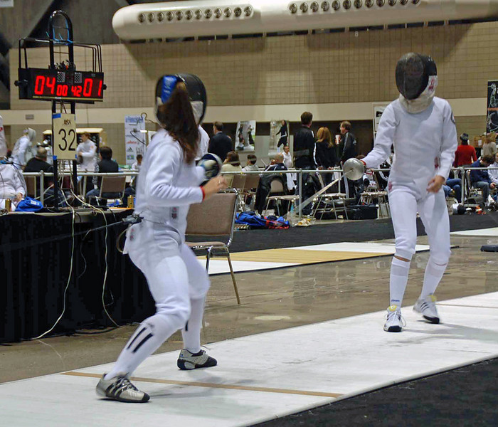 Nina Moiseiwitsch (left) is ahead in the bout in Junior Women's Epee.
