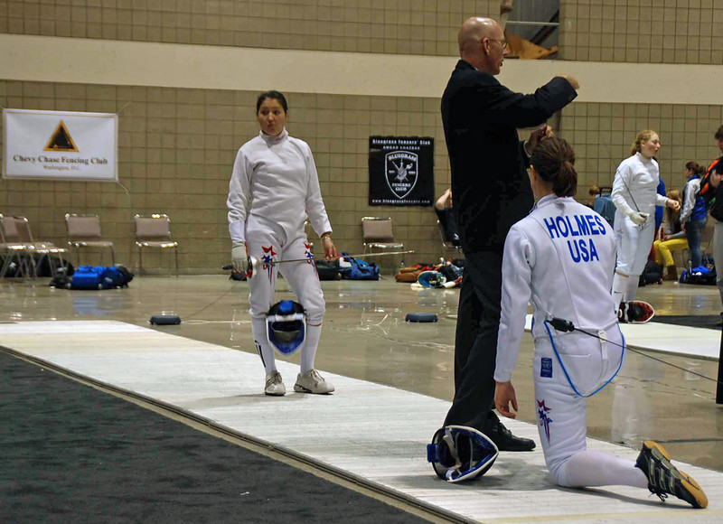 Katharine Holmes will compete against Dina Bazarbayeva in the round of 8 in Junior Women's Epee.  (Chevy Chase Fencing Club home base in the background.)