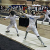 Carolyn Townsend (right) scores against Audrey Yuh in the Y14 Women's Epee DE round of 64.