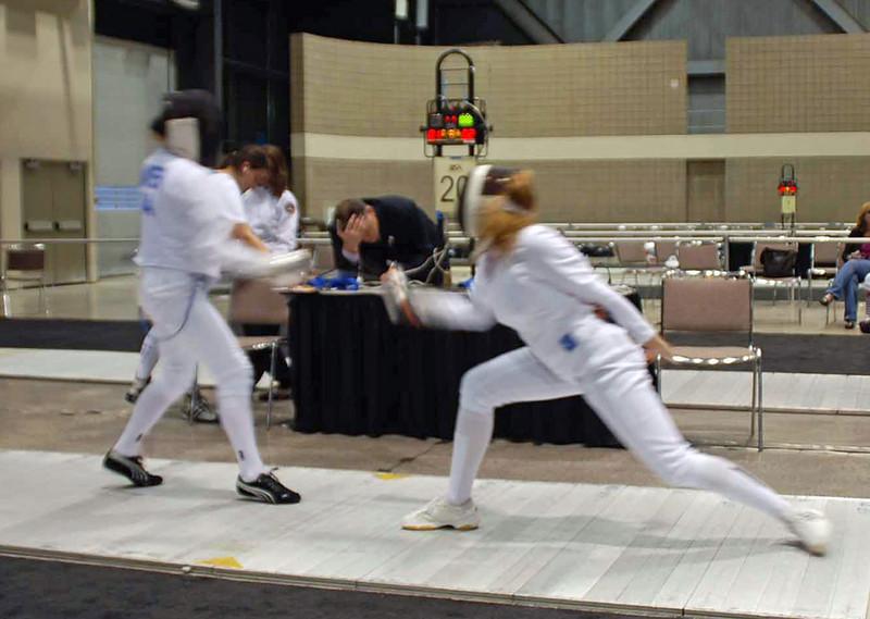 Ella Barnes (right) scores in Cadet Women's Epee.