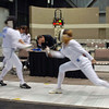 Ella Barnes (right) scores in Cadet Women's Epee.