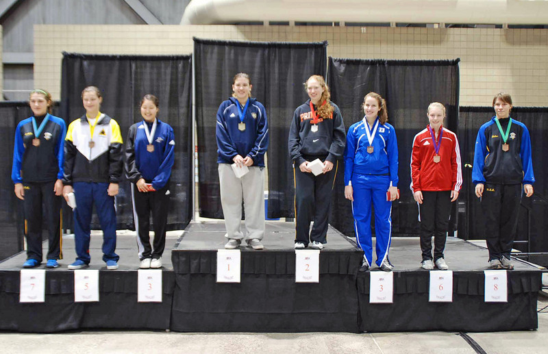The finalists in Junior Women's Epee.  From left: Isabella Barna (7th), Katharine Holmes (5th), Dina Bazarbayeva (3rd), Courtney Hurley (1st), Phoebe Caldwell (2nd), Emily D'Agostino (3rd), Catherine Lee (6th), Helen Jolley (8th).