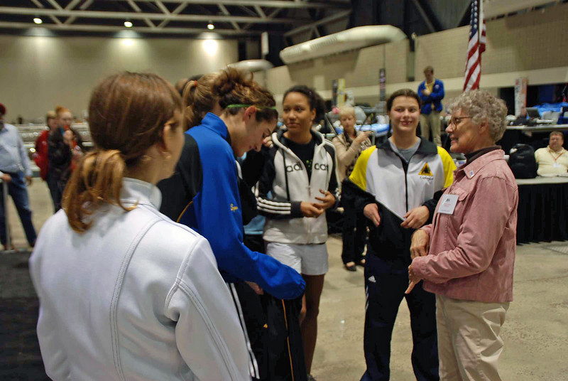The Cadet Women's Epee finalists gather before the award ceremony.